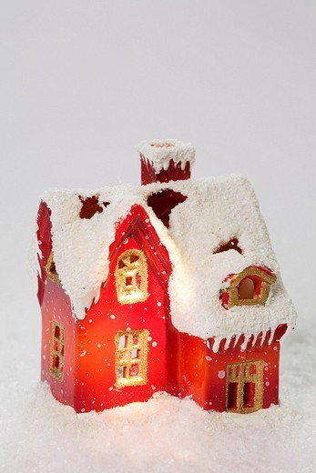 Festive house made of clay on artificial snow : Stock Photo