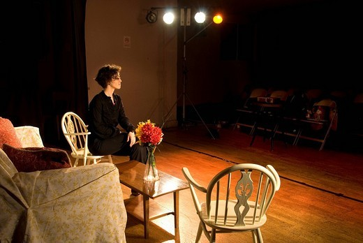 Stock Photo: 1848-120774 Woman sitting on a chair, stage, theatre, England, United Kingdom, Europe
