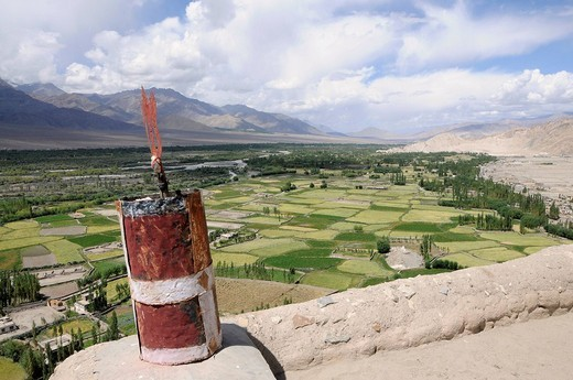Stock Photo: 1848-122564 Thikse Monastery, aerial picture of Indus Valley, river oasis with barley fields, irrigation, farms and mountainous desert, Buddhistic symbol on the roof in the front, Ladakh, Jammu and Kashmir, North India, Himalayas, Asia