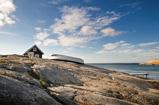 Green cabin with row boat, Smoegen, Bohuslaen, Sweden : Stock Photo