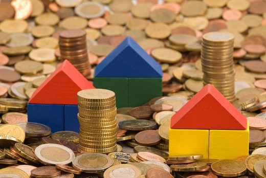 Stock Photo: 1848-124306 Housees made of toy building bricks on coins, symbolic picture for house and finances
