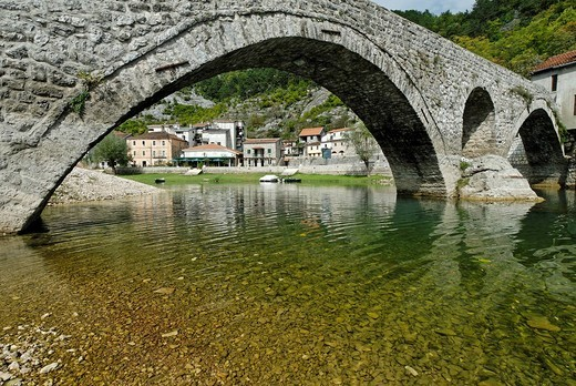 Historic stone bridge in Rijeka Crnojevica at Skutari lake, Montenegro : Stock Photo