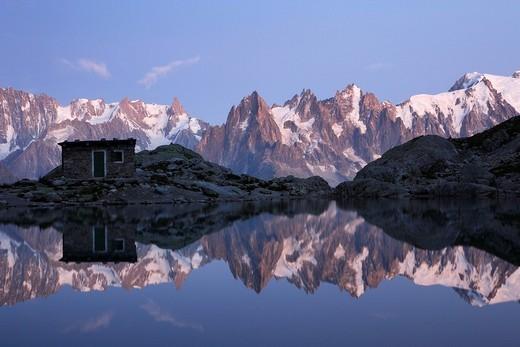 The Aiguilles de Chamonix mountains reflected in Lac Blanc lake, far right Mont Blanc, Haute_Savoie, France, Europe : Stock Photo