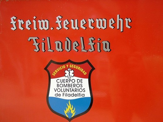 Bilingual emblem of the voluntary fire brigade, Mennonite colony, Filadelfia, Fernheim, Gran Chaco, Paraguay : Stock Photo