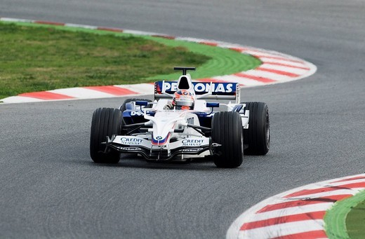Driver Robert Kubica in his BMW Sauber Formula 1 race car entering a corner on the Circuit de Catalunya race track in Barcelona, Spain : Stock Photo