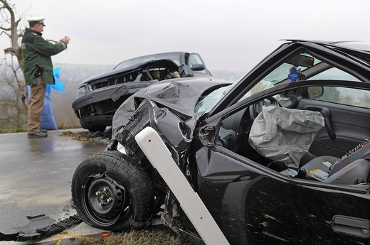 Police officer photographing car wrecks after a car accident for the acquisition of accident data, Nuertingen, Esslingen Region, Baden_Wuerttemberg, Germany, Europe : Stock Photo