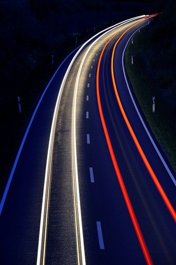 Road with traces of light from cars : Stock Photo