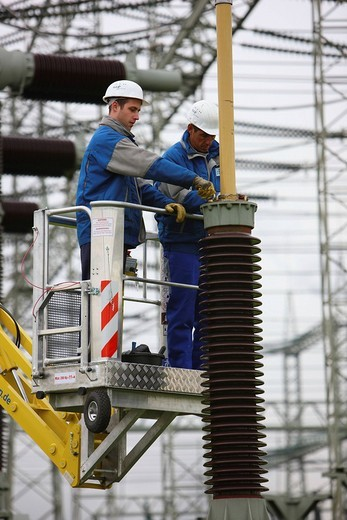 Stock Photo: 1848-128418 Workers doing maintenance work in a transformer station of the ELE, Emscher Lippe Energie GmbH, a subsiduary of the RWE, Marl, North Rhine_Westphalia, Germany, Europe
