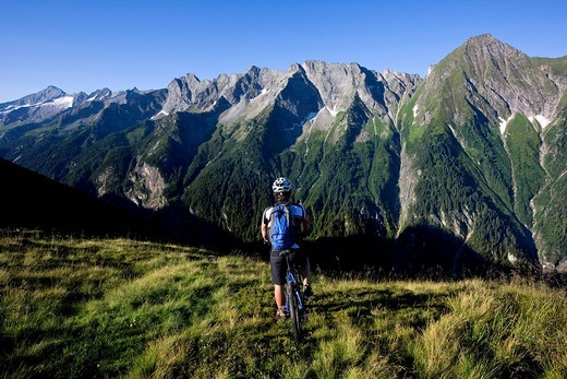 Mountain biker looking at the mountains, Zillertal Alps, Mayerhofen, North Tyrol, Austria, Europe : Stock Photo