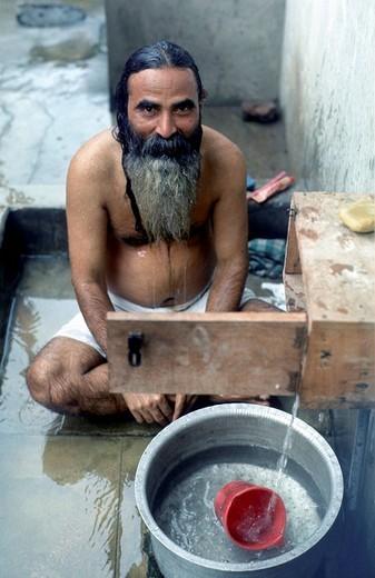 Sadhu, hinduistic holy man, morning wash, Padna, India : Stock Photo