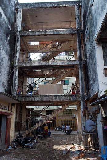 Staircase in a rotten appartment block, Dey Krahom slum area, Phnom Phen, Cambodia : Stock Photo