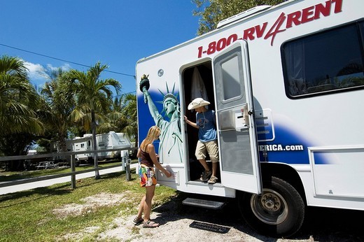 Woman and child with a motorhome on Boyd´s Campground in Key West, Florida, USA : Stock Photo
