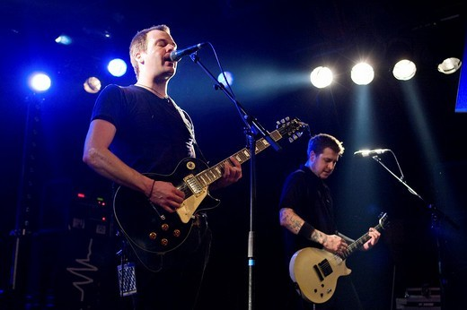 Rory Henderson, singer and guitarist, and Ryan Massey, guitarist and singer, members of the US rock band American Steel, live in the Schueuer Lucerne, Switzerland : Stock Photo