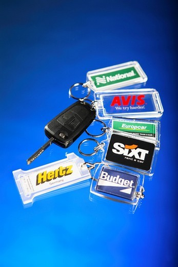 Car keys with key rings from various car rental companies : Stock Photo