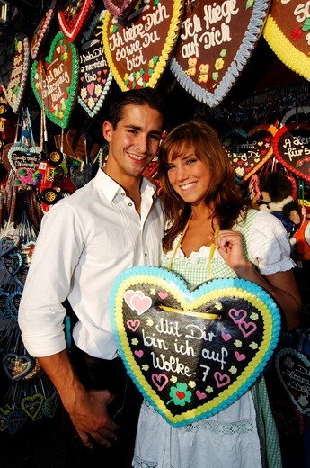 Oktoberfest Beer Festival, Wies´n, couple amongst gingerbread hearts, Munich, Bavaria, Germany, Europe : Stock Photo