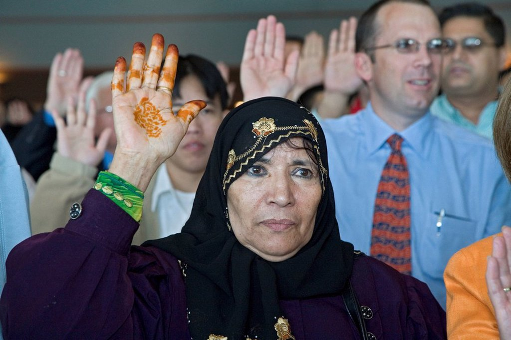 Stock Photo: 1848-132352 A woman from Yemen is one of 600 immigrants sworn in as new citizens of the United States, Detroit, Michigan, USA