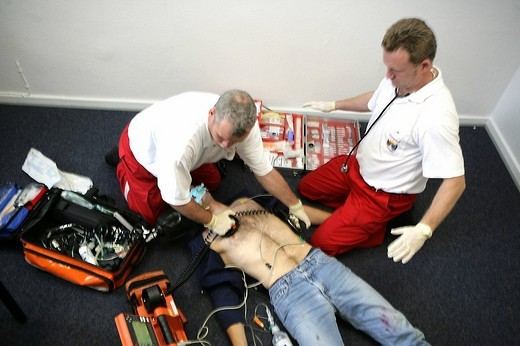 Stock Photo: 1848-133233 DEU Germany : Rescue paramedics in a private home attempt at resuscitation after a cardiac arrest. Training situation. ,