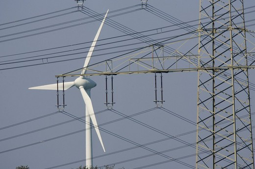 Wind energy plant and a pylon : Stock Photo