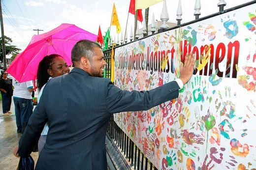 Multi_coloured handprints as a symbol of cooperation between people of various ethnic backgrounds during a protest against violence against women in Georgetown, Guyana, South America : Stock Photo