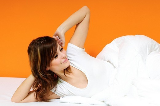 Stock Photo: 1848-133629 Young woman waking up