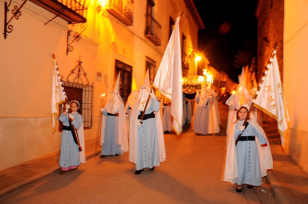 Stock Photo: 1848-133847 Penitents wearing penitential robes nazareno, Holy Week procession, Semana Santa, Belmonte, Castilla_La Mancha region, Spain