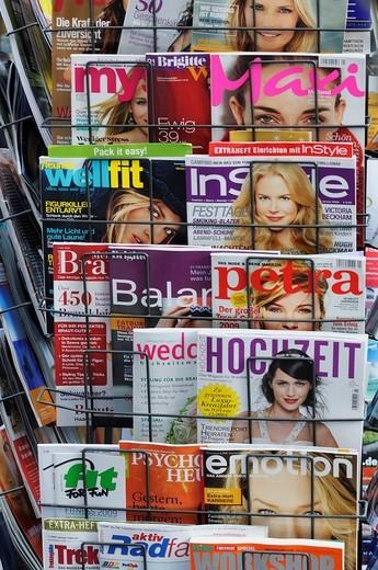 News rack with German women´s magazines : Stock Photo
