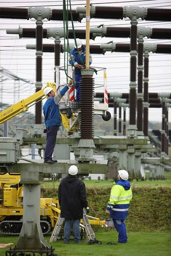 Workers doing maintenance work in a transformer station of the ELE, Emscher Lippe Energie GmbH, a subsiduary of the RWE, Marl, North Rhine_Westphalia, Germany, Europe : Stock Photo