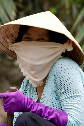 Vietnamese woman with mask, Vietnam, Asia : Stock Photo