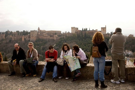 Stock Photo: 1848-135914 Tourist enjoying the view of the Moorish Alhambra Palace from the Mirador San Nicolas in the El Albayzín or Albaicín quarter of Granada, Andalusia, Spain