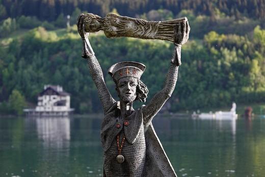 Statue of St. Domitian, created in 1994 by Prof. Giorgio Igne, Millstaetter See, Millstatt Lake, Millstatt, Carinthia, Austria, Europe : Stock Photo