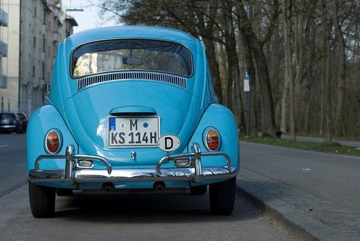 VW Beetle in light blue parked _ please efface number before publishing : Stock Photo