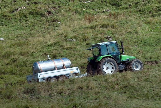 Transporting milk with a tractor, Schleimssattel Saddle, Karwendel Range, Tyrol, Austria, Europe : Stock Photo