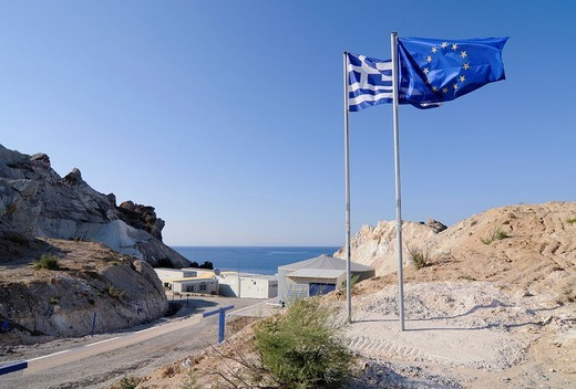 European and Greek flag, symbolic for the EU supported project, seawater desalination plant on Milos, Cyclades, Greece, Europe : Stock Photo
