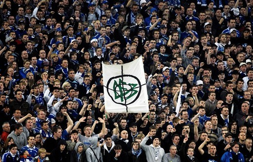 Schalke fans upholding banner with DFB logo in crosshairs, Football National League, FC Schalke 04 _ FC Bayern Muenchen 1:2, 9/11/08, Gelsenkirchen, North Rhine_Westphalia, Germany, Europe : Stock Photo