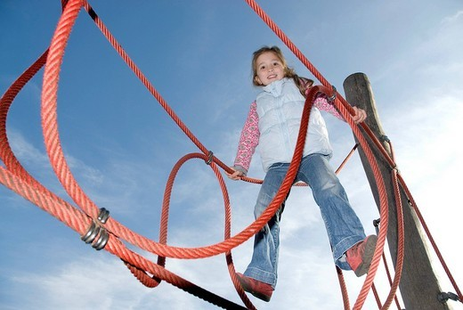 Young girl on a jungle gym : Stock Photo