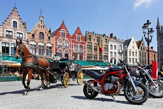 Horse carriage and motorcycles at the Great Market square, Brugge, Flanders, Belgium : Stock Photo