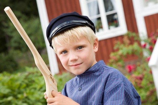 Boy dressed as a literary character at film shooting location and former home of Astrid Lindgren in Katthult/Gibberyd, Sweden, Scandinavia, Europe : Stock Photo