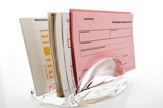 Money transfer forms in a plastic stand : Stock Photo