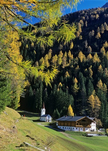 Stock Photo: 1848-141100 St Johann chapel and the Wanser farm, Wanser valley Passeier valley, South Tyrol, Italy
