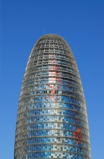 Modern Torre Agbar, tower, skyscraper, by architect Jean Nouvel, at Plaça de les Glories Catalanes in Barcelona, Catalonia, Spain, Europe : Stock Photo