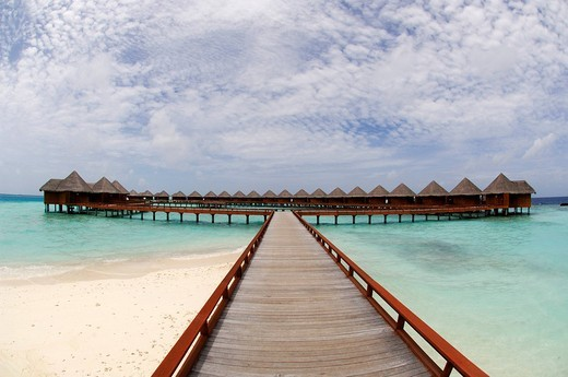 Jetty leading to water bungalows in Baros Resort, The Maldives, Indian Ocean : Stock Photo