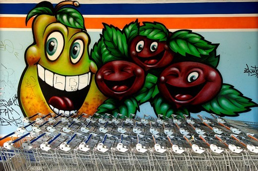 Stock Photo: 1848-148006 Graffiti, vegetables as comic figures on a supermarket, behind shopping trolleys, Berlin, Germany, Europe