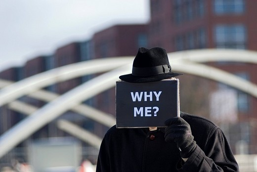Man holding a sign with the message, Why me, symbolic image for the economic crisis : Stock Photo