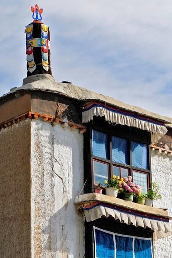Window with flowers, Palcho Monastery or Pelkor chode or Shekar, Gyantse, Tibet : Stock Photo