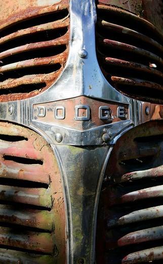 Dogde logo on rosty radiator grill : Stock Photo