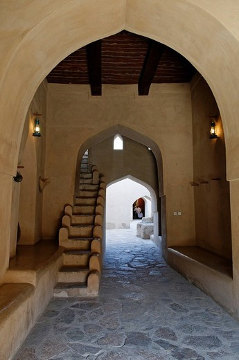 Historic adobe fortification Nizwa Fort or Castle, entrance gate, Hajar al Gharbi Mountains, Dhakiliya Region, Sultanate of Oman, Arabia, Middle East : Stock Photo