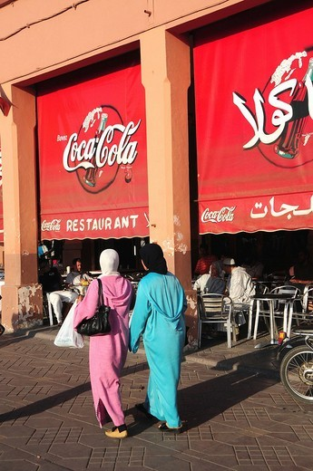 Stock Photo: 1848-151924 Two veiled women in front of arabic coca_cola advertisement in Djemma el_Fna Square, Imposter Square or Square of the Hanged, Marrekesh, Morocco, Africa
