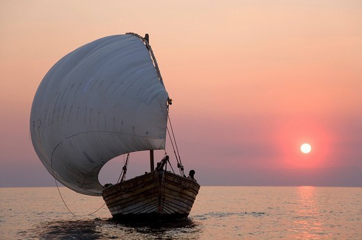 Stock Photo: 1848-15214 Dhow, african sailing boat before sunset, Pumulani Lodge, Lake Malawi, Malawi, South East Africa