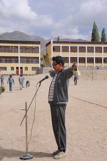 Teacher as a model at the morning report in the Indian school system at a school in Lamdon, Leh, Jammu and Kashmir, India, Himalayas, Asia : Stock Photo