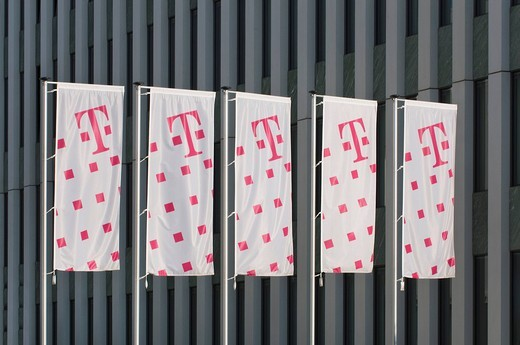 Five Telekom flags in front of an office building facade, Deutsche Telekom AG, Bonn, North Rhine_Westphalia, Germany, Europe : Stock Photo